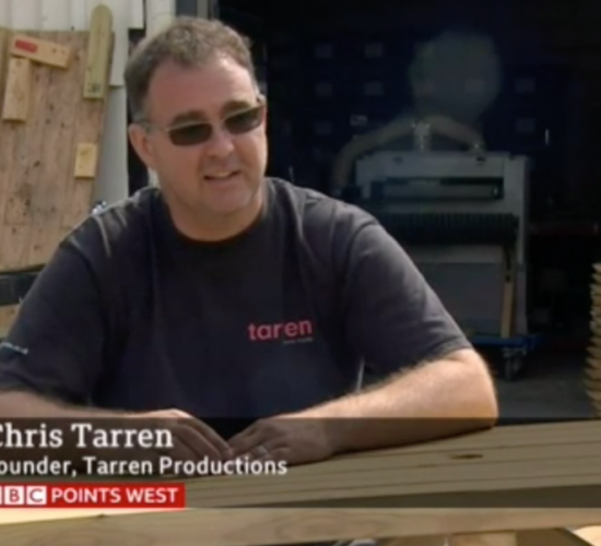 Man sitting at bench for TV interview